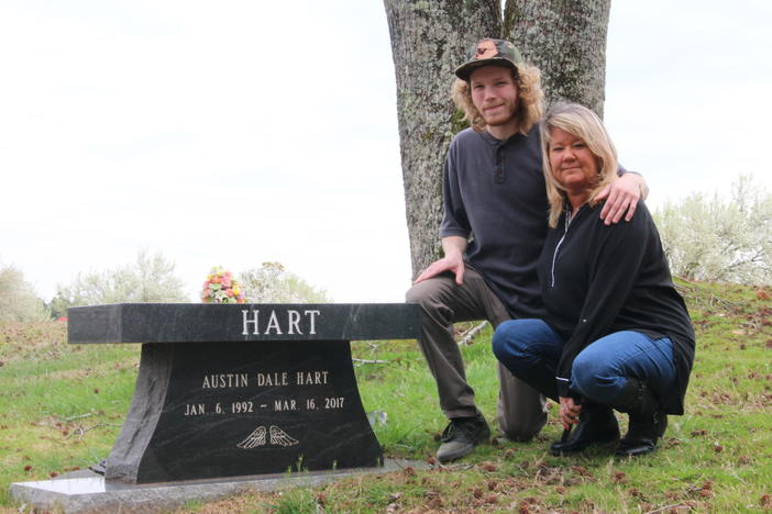 Son Preston Wysocki (left) and mother Heather Wysocki visit the grave of brothers/son Austin Hart and Dustin Hart Saturday, March 14, 2020.