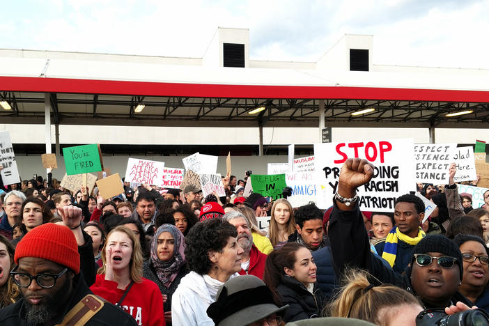 Demonstrators gather at Hartsfield-Jackson Atlanta International Airport on January 29 to protest President Trump's executive action on refguees and immigration.