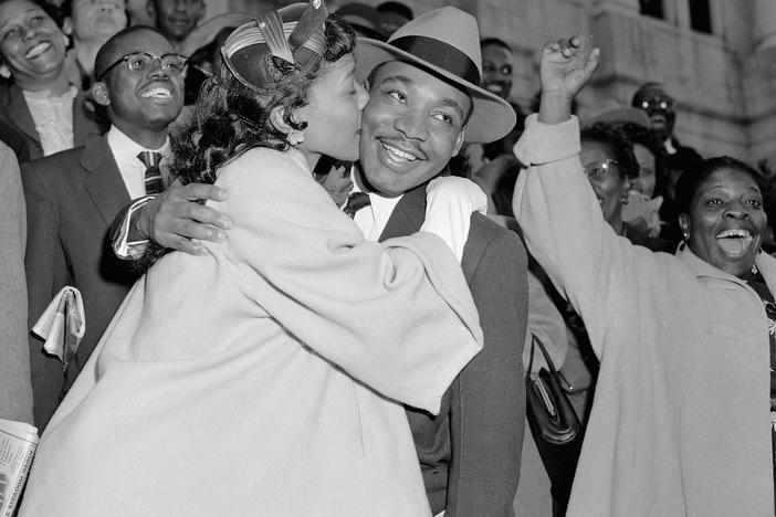 The Rev. Martin Luther King Jr. is welcomed with a kiss by his wife Coretta after leaving court in Montgomery, Ala., March 22, 1956.