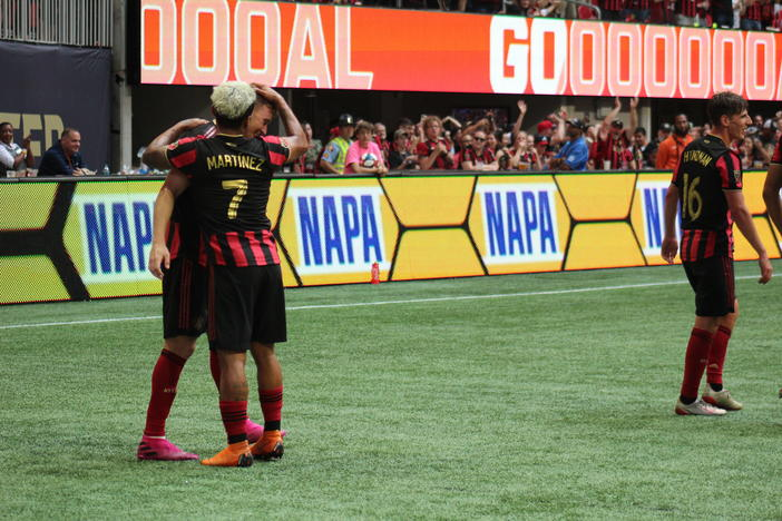 Atlanta United forward Josef Martinez celebrates a goal by midfielder Julian Gressel in the second half of an MLS match against New England, Sunday, Oct. 6, 2019, in Atlanta.