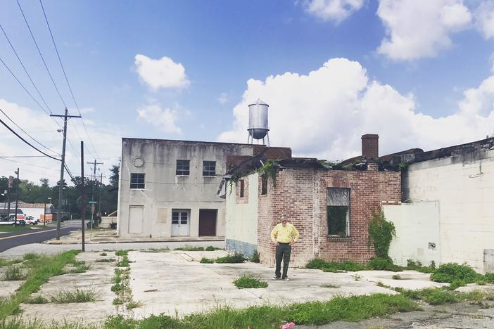 GPB's Don Smith walks around in front of the former Star Theatre on Quitman's South side.
