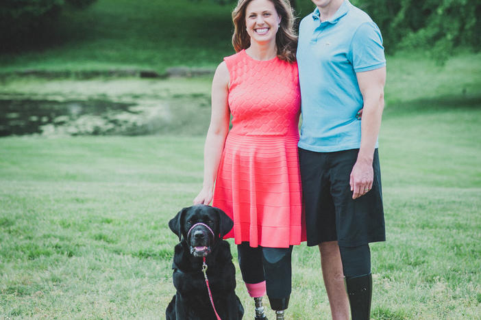 Authors, Jessica Kensky and Patrick Downes pictured with service dog, Rescue.