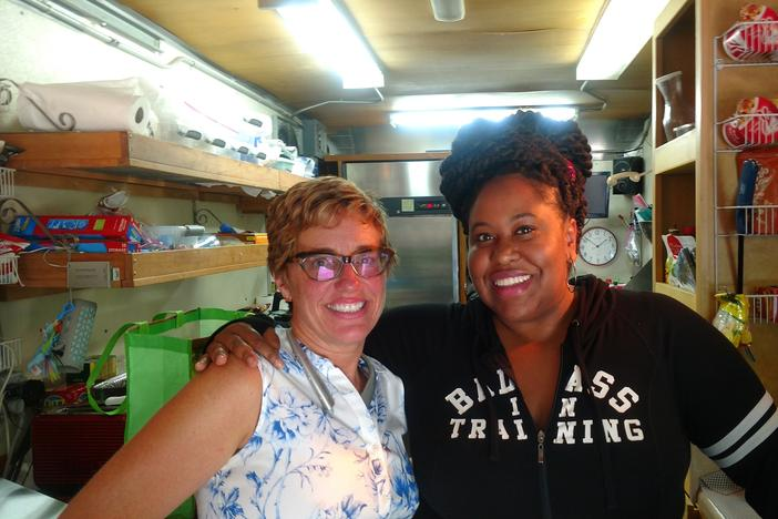 Stephanie Morales and Kalena Boller on Stephanie's food truck during a TV production in Stone Mounrtain.