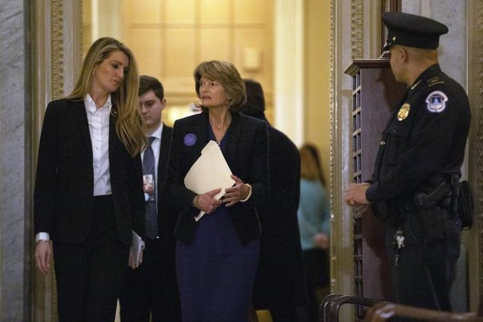 Sen. Kelly Loeffler, R-Ga., left, and Sen. Lisa Murkowski, R-Alaska, walk on Capitol Hill in Washington, Thursday, Jan. 30, 2020, as they return to the Senate chamber after a break in the impeachment trial of President Donald Trump.