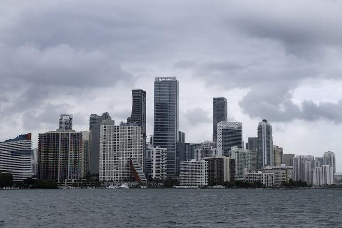 "Clouds loom over the Miami skyline Thursday, May 14, 2020. According to the National Hurricane Center website, ""A trough of low pressure over the Straits of Florida is producing a large area of cloudiness and thunderstorms."""