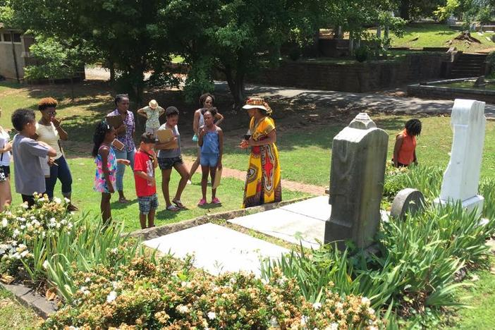 Genealogist and historian D. L. Henderson leads a tour of African American gravesites at Oakland Cemetery in Atlanta on June 11, 2016.