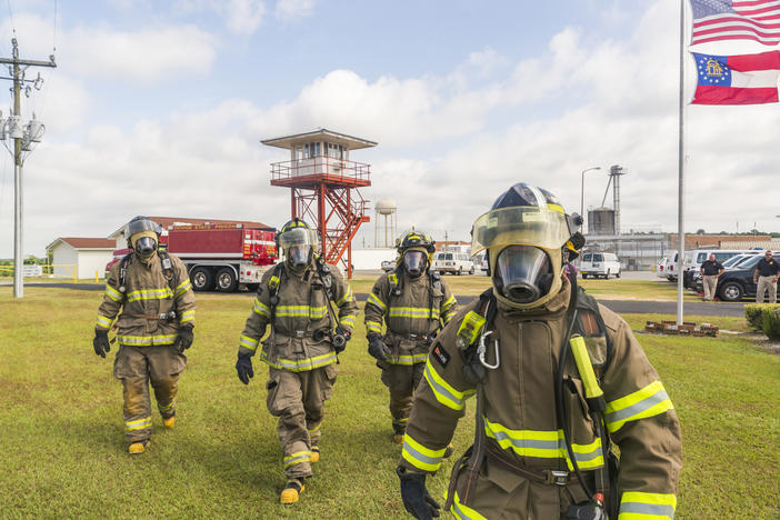 Firefighters from the Dodge State Prison fire department during a recent training demonstration. The fire department regularly aids local volunteer departments and even spent weeks fighting wildfires around the Okefenokee Swamp.