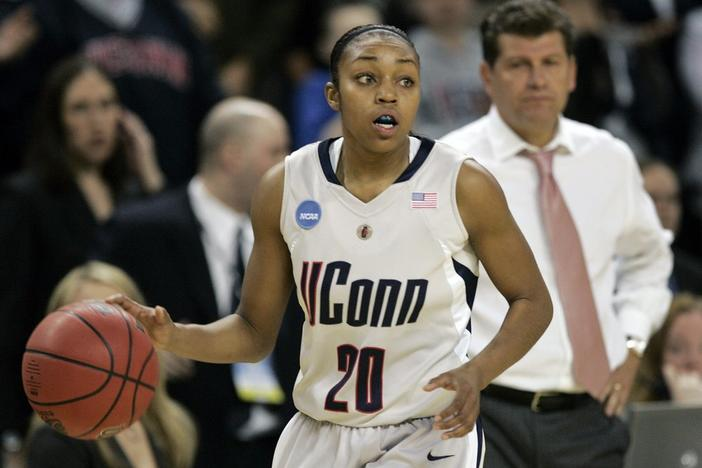 In this March 31, 2009, file photo, Connecticut guard Renee Montgomery brings the ball up during the second half of a women's NCAA college basketball tournament regional final against Arizona State in Trenton, N.J.