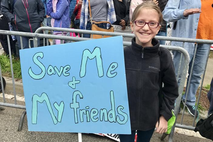 11-year-old Anneleise Dunn proudly holds the sign she carried at the March For Our Lives Rally on Saturday, March 24, 2018, in Atlanta.