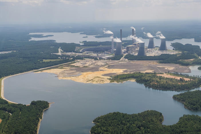 Georgia Power's Plant Scherer with the coal ash pond, foreground, where residuals from burning coal at the plant are stored. The pond goes to depths of 80 feet in some places and comes into contact with groundwater.