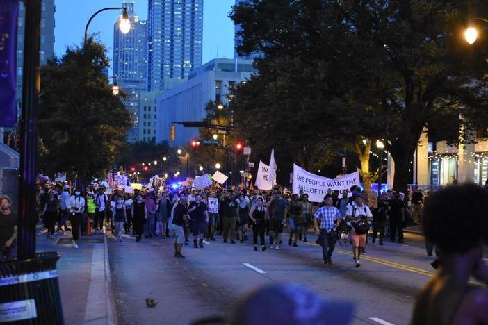 Protesters march down Peachtree Street in Atlanta, on the way to Piedmont Park.