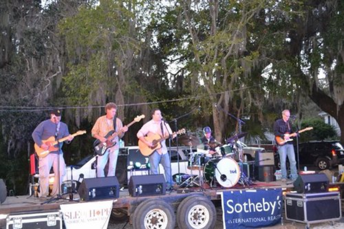A local band plays by the pier at the Fourth Friday Pavilion at Isle of Hope Marina.