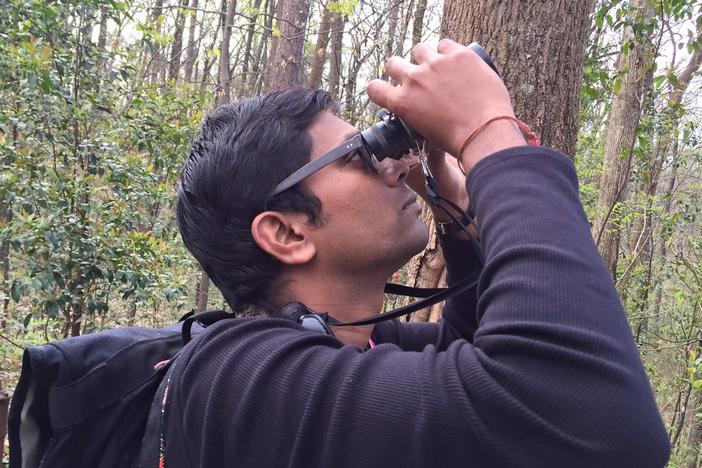 Vinod Babu helps  lead a bird watch near the Fernbank Museum in Atlanta on March 19, 2016.