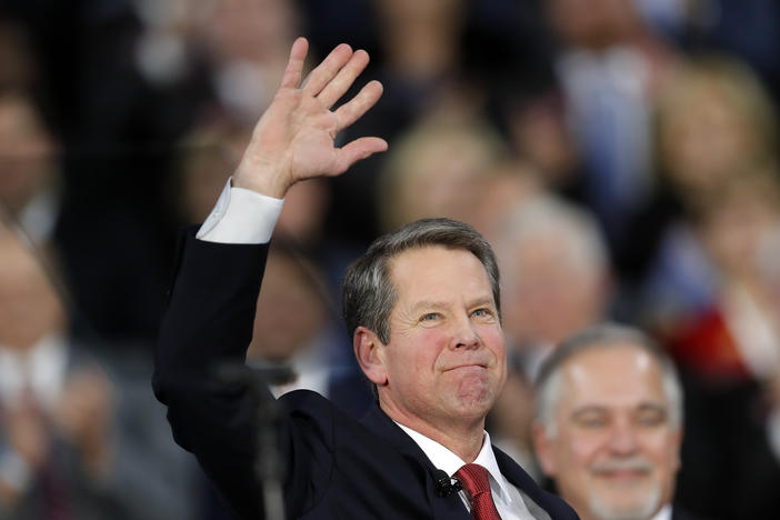Brian Kemp waves after being sworn in as Georgia's governor during a ceremony at Georgia Tech's McCamish Pavilion, Monday, Jan. 14, 2019, in Atlanta. (AP Photo/John Bazemore)