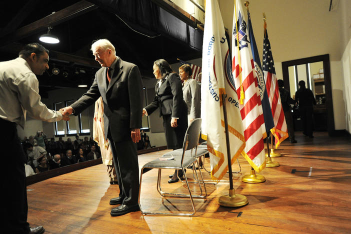 Former U.S. President Jimmy Carter congratulates newly sworn in citizens in Plains in 2013.