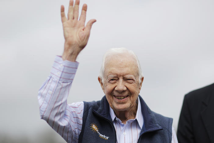 Former President Jimmy Carter waves during a ribbon cutting ceremony for a solar panel project on farmland he owns in their hometown of Plains, Ga., Wednesday, Feb. 8, 2017.