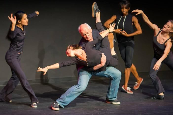 Colin Mochrie performs with dancers at Dad's Garage.