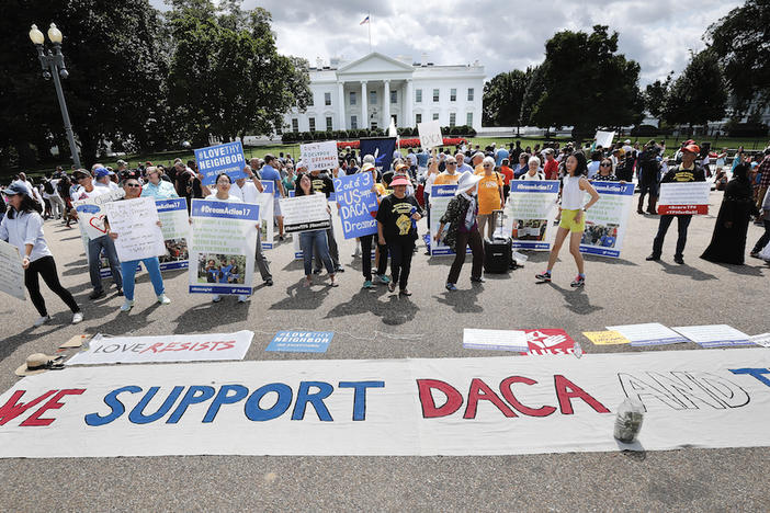 In this Sunday, Sept. 3, 2017 photo, supporters of Deferred Action for Childhood Arrivals program (DACA), demonstrate on Pennsylvania Avenue in front of the White House in Washington.