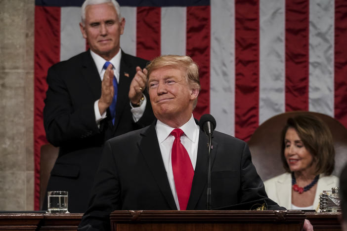President Donald Trump gives his State of the Union address to a joint session of Congress, at the Capitol in Washington, as Vice President Mike Pence, left, and House Speaker Nancy Pelosi look on. In Trump's estimation, the good times began to roll for t