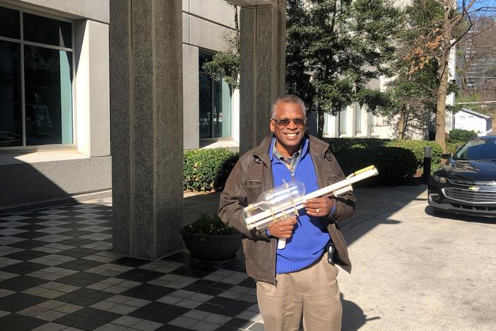 Dr. Lonnie Johnson pictured with his prototype for the Super Soaker.