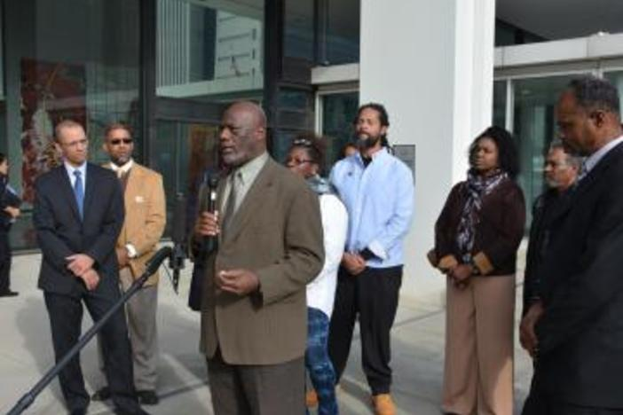 Members of Sapelo Island's Gullah Geechee community speak after filing their lawsuit in Atlanta.