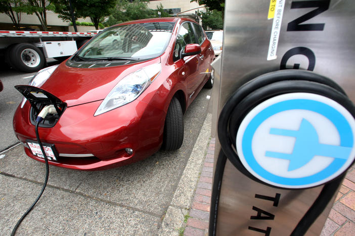 A Nissan Leaf charges at an electric vehicle charging station in Portland, Oregon.