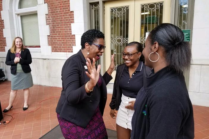 Savannah-Chatham Schools Superintendent Ann Levett talks with Savannah Arts Academy seniors Rishe Williams (center) and A'lani Coppock after announcing the district's partnerhsip to encourage FAFSA completion.