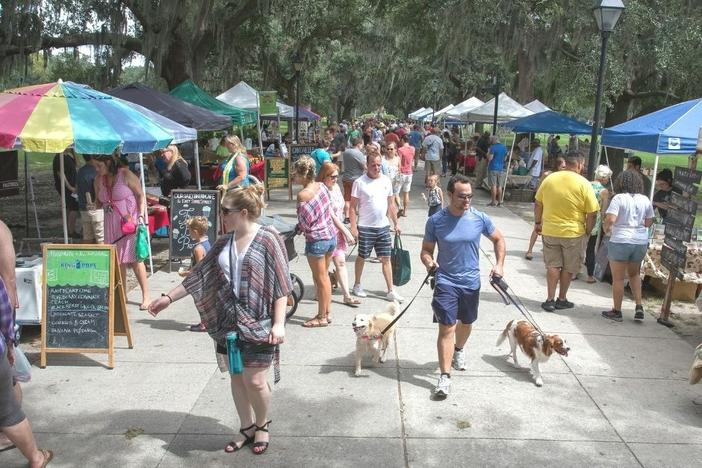 Customers shop at Forsyth Farmers' Market.