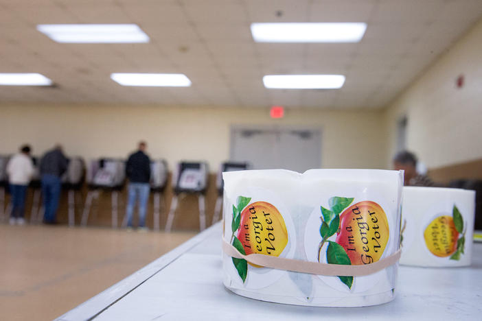 """I'm a Georgia Voter"" stickers with peaches are handed out to residents as they vote during Georgia's primary election at their polling station at South Lowndes Recreation Complex in Lake Park, Ga., Tuesday, March 1, 2016."