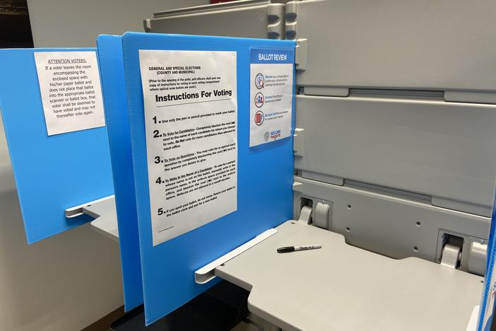 A voting booth is equipped with a Sharpie and instructions to use hand-marked paper ballots on March 24.