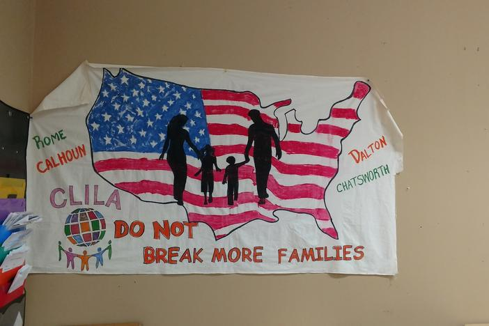 A sign hangs up in the offices of Coalicion de Lideres Latinos in Dalton, Georgia. The group provides support for immigrants in the area.