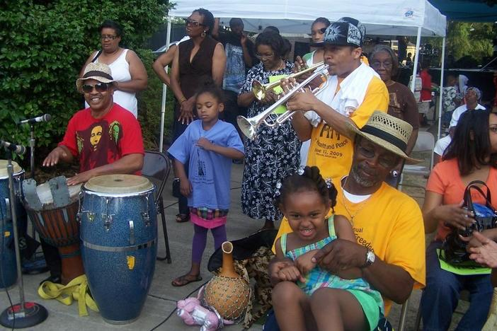 Musicians and attendees interact at a previous Juneteenth Freedom Festival in Macon. This year is the festival's 27th year, and it takes place Saturday in Tattnall Square Park.