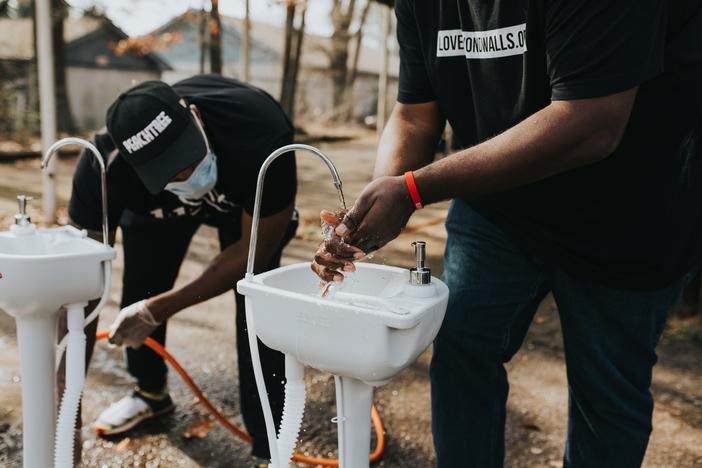 Love Beyond Walls volunteers help set up handwashing stations around Atlanta to help people experiencing homelessness protect themselves against the spread of coronavirus.
