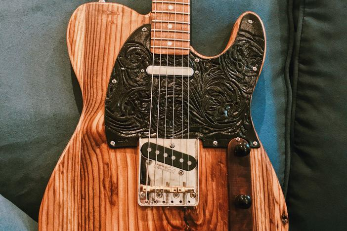 Atlanta musician Maggie Schneider's guitar is made from the wood of the Excelsior Mill in downtown Atlanta, former home of the Masquerade music venue.