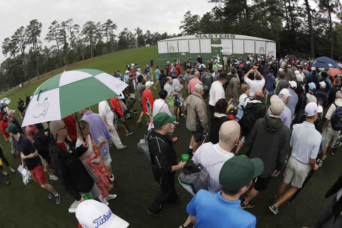 Fans leave Augusta National for a weather warning during a practice round for the Masters golf tournament Wednesday, April 5, 2017, in Augusta, Ga.