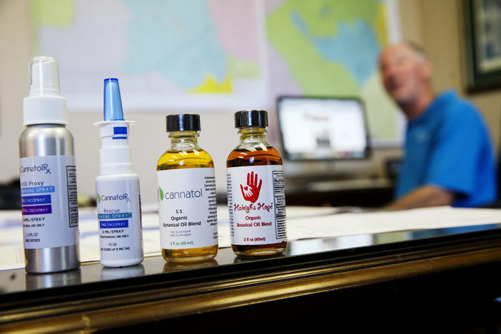 In this Monday, April 17, 2017 photo, various cannabis oil products are displayed in the office of Georgia State Rep. Allen Peake in Macon, Ga.