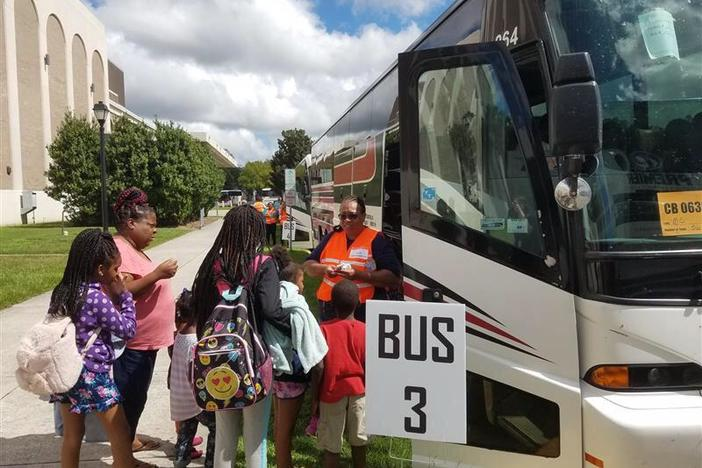 Evacuees board buses outside the Savannah Civic Center heading to Augusta ahead of Hurricane Dorian in September 2019.