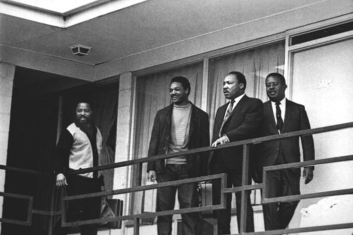 The Rev. Martin Luther King Jr. stands with other civil rights leaders on the balcony of the Lorraine Motel in Memphis, Tenn., on April 3, 1968, a day before he was assassinated at approximately the same place.