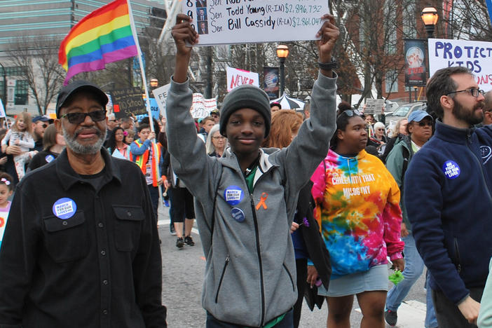 Sixteen-year-old Niles Francis, a student at South Cobb High School, marched with grandfather, Jerry Pennick. Francis is lobbying the Georgia General Assembly to pass SB 457, a school safety bill requiring more active shooter drills.
