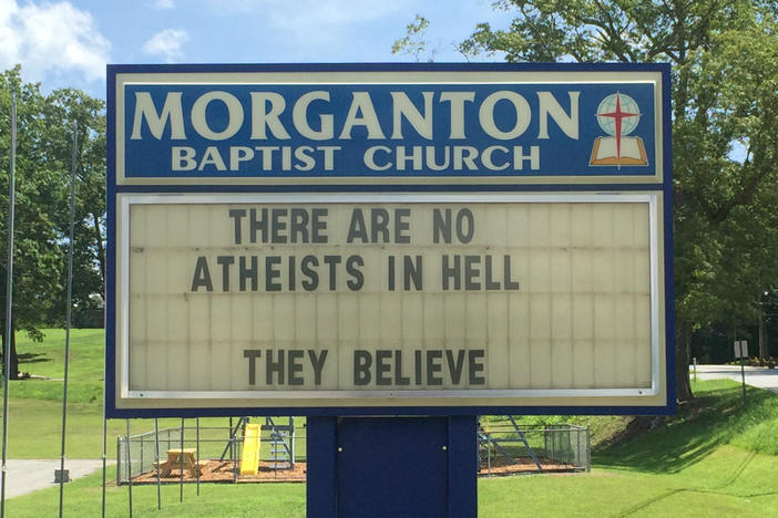 "A sign in front of the Morganton Baptist Church reads, ""There are no atheists in hell. They believe."""