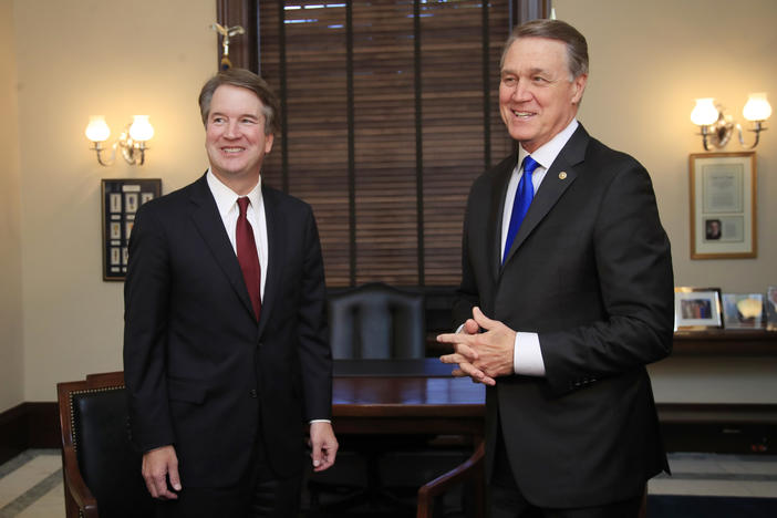 Supreme Court nominee Brett Kavanaugh meets Sen. David Perdue on Capitol Hill in Washington.