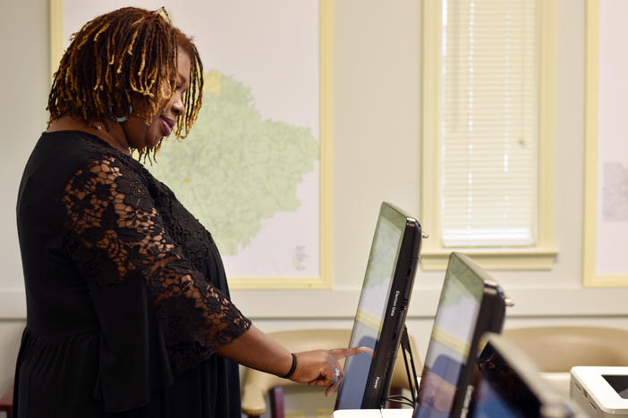 Henry County Elections Director Ameika Pitts casts a ballot in a mock election Wednesday, Feb. 26, 2020.