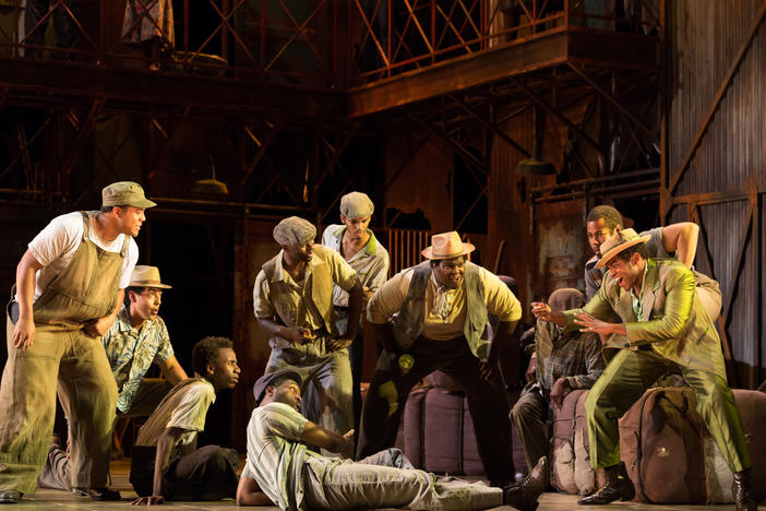 A scene fom the 2017 Glimmerglass production of 'Porgy and Bess': the men of Catfish Row gather around the craps game. The Atlanta Opera is staging 'Porgy and Bess' for five performances between Mar. 7 and 15.