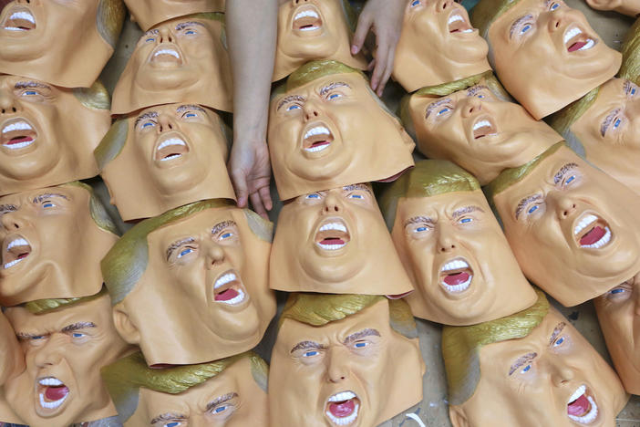 A worker prepares for final touches on rubber masks depicting President-elect Donald Trump at the Ogawa Studio in Saitama, north of Tokyo, Tuesday, Nov. 15, 2016.