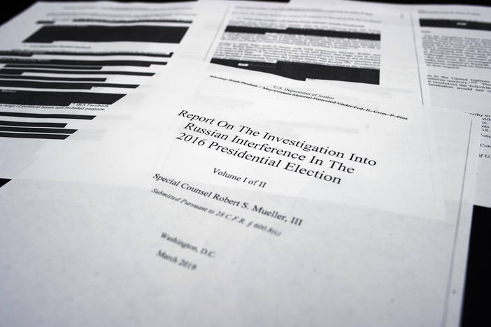Four pages of special counsel Robert Mueller report on the witness table in the House Intelligence Committee hearing room on Capitol Hill, in Washington, Thursday, April 18, 2019.