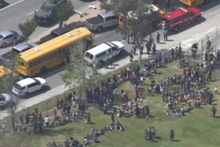 This screenshot from NBC L.A. shows students gathered outside North Park Elementary School following a shooting at the school on Monday, April 10, 2017.
