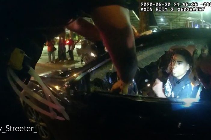 A screengrab from now-fired Officer Ivory Streeter's body camera footage shows driver Messiah Young being stunned after officers broke his driver's side window.