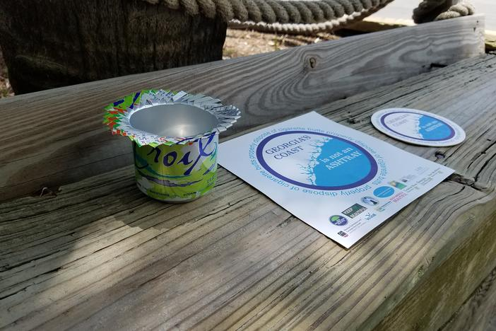 "Flyers, coasters and ashtrays made from empty cans are helping spread the message that ""Georgia's coast is not an ashtray"""