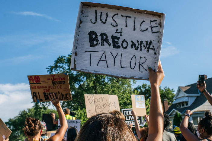 People march in the streets during a demonstration on June 26 in Minneapolis, Minn.  The march honored Breonna Taylor, who was shot and killed by members of the Louisville Metro Police Department on March 13.