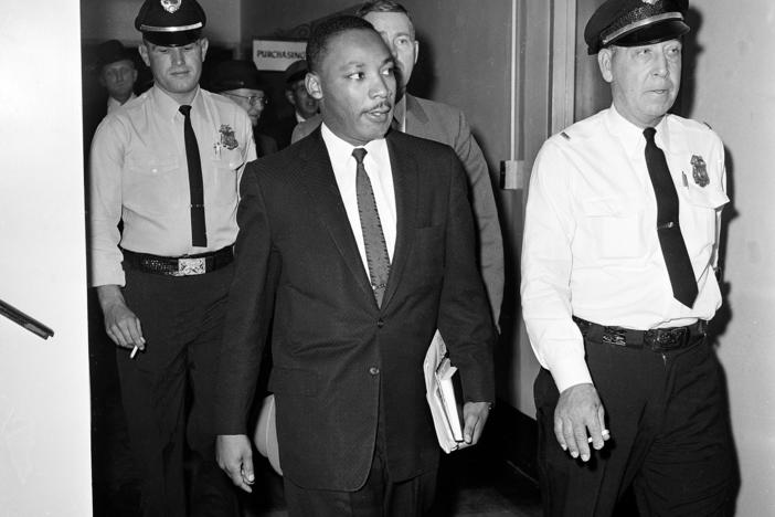 In this Oct. 25, 1960 file photo, Dr. Martin Luther King Jr. leaves court after being given a four-month sentence in Decatur, Ga., for taking part in a lunch counter sit-in at Rich's department store.
